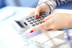 Businesswoman using calculator Stock Photography