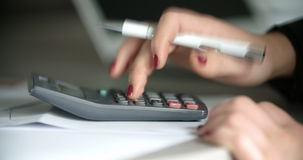 Businesswoman using a calculator in office. Close up of a businesswoman hand using calculator in office. Corporate, financial background stock video footage