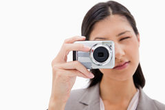 Businesswoman using camera Royalty Free Stock Photos