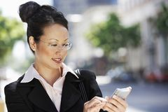 Businesswoman Using Cell Phone Stock Image