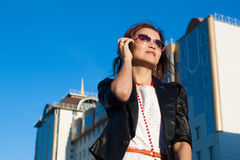 Businesswoman using a cell phone in the city royalty free stock photo