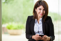 Businesswoman using a cell phone Royalty Free Stock Photo