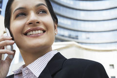 Businesswoman Using Cell Phone In Front Of Building Stock Photos