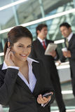 Businesswoman Using Cell Phone Outside Office Stock Image