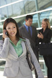 Businesswoman Using Cell Phone Outside Office Royalty Free Stock Photo