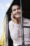 Businesswoman Using Cell Phone In Tuk-Tuk Taxi Royalty Free Stock Photo