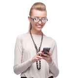 Businesswoman using cell phone Stock Images
