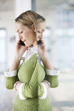 Businesswoman Using Cellphone In Office Royalty Free Stock Photography