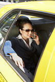 Businesswoman Using Cellphone In Taxi Royalty Free Stock Photography