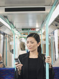 Businesswoman Using Cellphone In Train Stock Photography