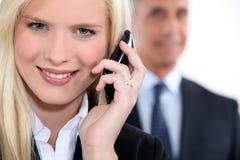 Businesswoman using a cellphone Stock Photo