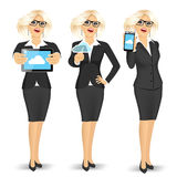 Businesswoman using cloud computing on different devices Stock Photography