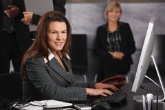 Businesswoman using computer Stock Photo