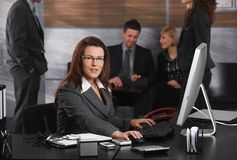 Businesswoman using computer Stock Images