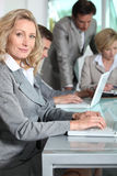 Businesswoman using a computer Stock Photography