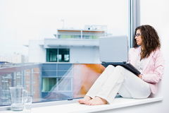 Businesswoman using computer Royalty Free Stock Images