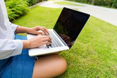 Businesswoman using computer laptop in garden outdoor, Work and. Businesswoman using computer laptop in garden outdoor., Work and technology concept Royalty Free Stock Photos