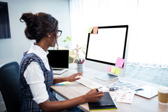 Businesswoman using a computer Stock Image