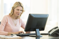 Businesswoman Using Computer In Office Stock Photos