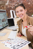 Businesswoman using computer at office desk Stock Photo