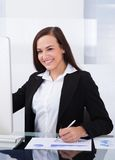 Businesswoman using computer in office Stock Images