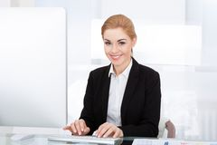 Businesswoman using computer Stock Image