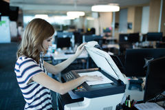 Businesswoman using copy machine in office Royalty Free Stock Photos