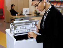 Businesswoman using copy machine Royalty Free Stock Photo