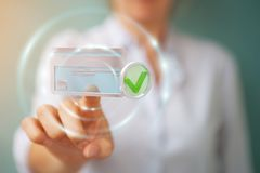 Businesswoman using credit card to pay online 3D rendering. Businesswoman on blurred background using credit card to pay online 3D rendering Stock Images