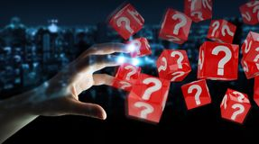 Businesswoman using cubes with 3D rendering question marks. Businesswoman on blurred background using cubes with 3D rendering question marks Stock Image