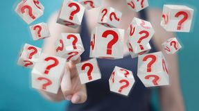 Businesswoman using cubes with 3D rendering question marks. Businesswoman on blurred background using cubes with 3D rendering question marks Stock Photos