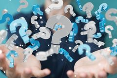 Businesswoman using 3D rendering question marks. Businesswoman on blurred background using 3D rendering question marks Royalty Free Stock Images