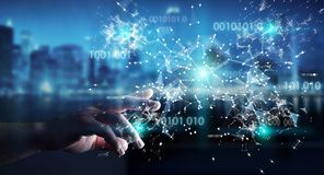 Businesswoman using digital binary code connection network 3D re. Businesswoman on blurred background using digital binary code connection network 3D rendering Royalty Free Stock Image