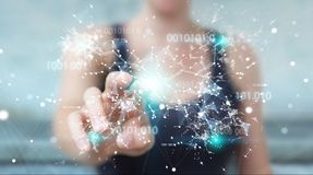 Businesswoman using digital binary code connection network 3D re. Businesswoman on blurred background using digital binary code connection network 3D rendering Royalty Free Stock Photos