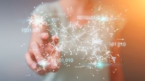 Businesswoman using digital binary code connection network 3D re. Businesswoman on blurred background using digital binary code connection network 3D rendering Royalty Free Stock Photo