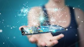 Businesswoman using digital binary code on mobile phone 3D rende. Businesswoman on blurred background using digital binary code on mobile phone 3D rendering Royalty Free Stock Image