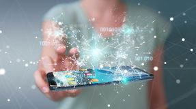 Businesswoman using digital binary code on mobile phone 3D rende. Businesswoman on blurred background using digital binary code on mobile phone 3D rendering Royalty Free Stock Images