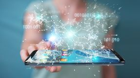Businesswoman using digital binary code on mobile phone 3D rende. Businesswoman on blurred background using digital binary code on mobile phone 3D rendering Stock Photo
