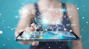 Businesswoman using digital binary code on mobile phone 3D rende. Businesswoman on blurred background using digital binary code on mobile phone 3D rendering Stock Photos