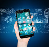 Businesswoman using digital mobile phone charts interface Stock Photography