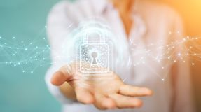 Businesswoman using digital padlock with data protection 3D rend. Businesswoman on blurred background using digital padlock with data protection 3D rendering Royalty Free Stock Photography