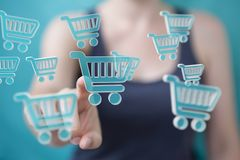 Businesswoman using digital shopping icons 3D rendering. Businesswoman on blurred background using digital shopping icons 3D rendering Stock Photos