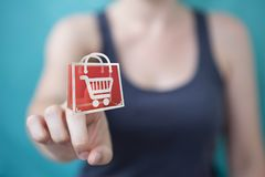 Businesswoman using digital shopping icons 3D rendering. Businesswoman on blurred background using digital shopping icons 3D rendering Royalty Free Stock Photos
