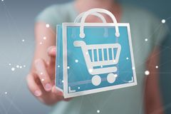 Businesswoman using digital shopping icons 3D rendering. Businesswoman on blurred background using digital shopping icons 3D rendering Royalty Free Stock Photo