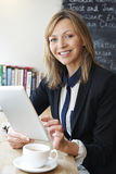 Businesswoman Using Digital Tablet  In Cafe Royalty Free Stock Image