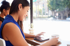 Businesswoman Using Digital Tablet In Coffee Shop Royalty Free Stock Photo