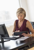 Businesswoman Using Digital Tablet At Desk Stock Photography