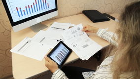 Businesswoman using digital tablet with graphs. Cropped image of businessman using digital tablet with colleagues at desk in office stock video footage