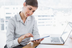 Businesswoman using digital tablet Stock Photos