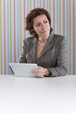 Businesswoman using a digital tablet Stock Photography
